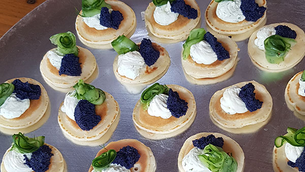 Mini blini with lumpfish caviar, quick pickled cucumber and dill
